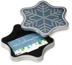 Dieser Amazon Geschenkgutschein ist in einer festlichen Schneeflocken-Geschenkverpackung untergebracht.